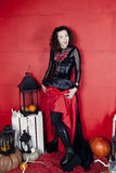 Young woman in photo studio on Halloween. Young women in photo studio stock images