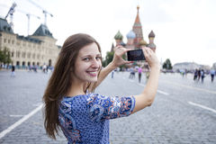 Young woman photographed attractions in Moscow Stock Image
