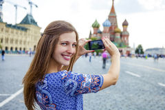 Young woman photographed attractions in Moscow Stock Photos
