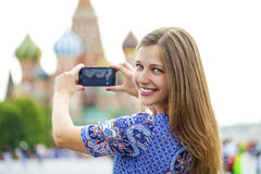 Young woman photographed attractions in Moscow Royalty Free Stock Photo