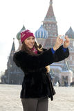 Young woman photographed attractions in Moscow Stock Images