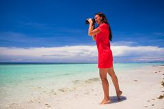 Young woman photographed beautiful sea on white Royalty Free Stock Photo