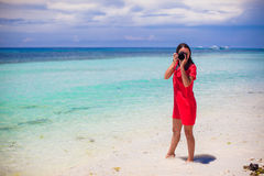 Young woman photographed beautiful seascape on Royalty Free Stock Photography