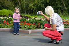 A young woman photographed his little son Royalty Free Stock Images