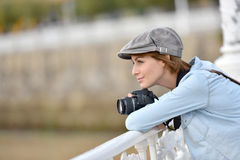 Young woman photographer admiring scene Royalty Free Stock Photography