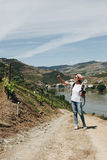 Young woman photographer in beautiful vineyards in Portugal Royalty Free Stock Images