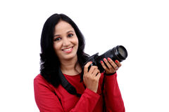 Young woman photographer with camera Stock Photos
