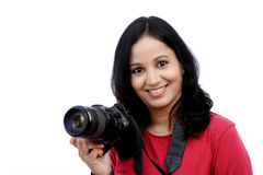 Young woman photographer with camera Stock Image