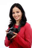 Young woman photographer with camera Stock Photo