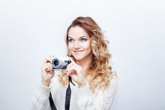 Young  woman photographer with camera, portrait on Royalty Free Stock Images