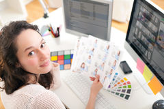 Young woman photographer choosing pictures Stock Photography