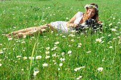 Young woman photographer in grass Stock Image