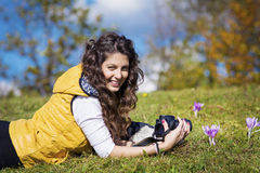 Young woman photographer laying outdoor Stock Images