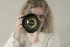 Young woman photographer Stock Photos