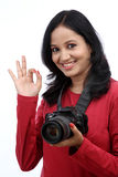 Young woman photographer making Ok sign Stock Image