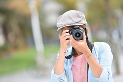 Young woman photographer making photos Stock Images