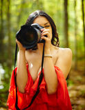 Young woman photographer outdoor Royalty Free Stock Image