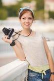 Young woman photographer portrait. Soft colors. Stock Photos