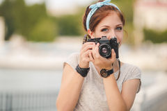 Young woman photographer portrait. Soft colors. Stock Image