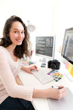 Young woman photographer processing pictures Stock Photos