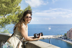 Young woman photographer on a sea background Royalty Free Stock Photo