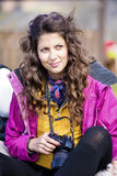 Young woman photographer. Smiling Brunette woman photographer outdoor Stock Photography