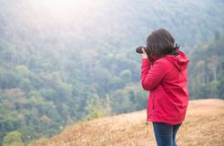Young woman photographer take forest picture. Travel concept Stock Photography