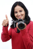 Young woman photographer taking images Stock Image