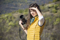 Young woman photographer taking photo of a beautiful mountain Royalty Free Stock Photography