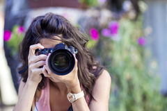 Young woman photographer taking photos outdoor Royalty Free Stock Image