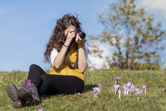 Young woman photographer taking photos outdoor Stock Photography