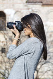 Young woman photographer taking photos outdoor Royalty Free Stock Images