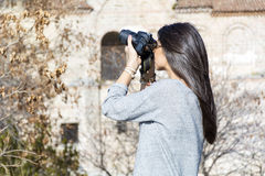 Young woman photographer taking photos outdoor Royalty Free Stock Photo