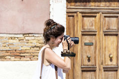 Young woman photographer taking photos outdoor Royalty Free Stock Photos