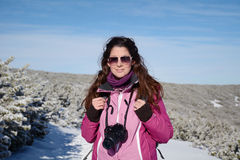 Young woman photographer taking photos in the winter mountain Stock Photography