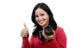 Young woman photographer with thumbs up gesture Stock Image