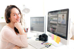 Young woman photographer working in her office Royalty Free Stock Photography