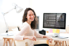 Young woman photographer working in her office Royalty Free Stock Images