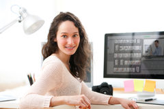 Young woman photographer working in her office Stock Image