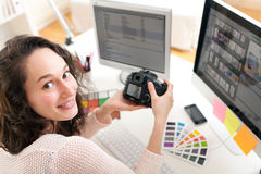 Young woman photographer working in her office Royalty Free Stock Image
