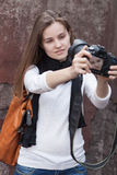 Young woman photographes itself Stock Image