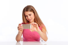 Young woman photographing Royalty Free Stock Photography