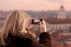 Young woman photographing city of Vilnius Royalty Free Stock Image