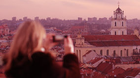 Young woman photographing city of Vilnius Royalty Free Stock Photo
