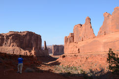 Young Woman Photographing Park Avenue in Arches National Park Royalty Free Stock Photography