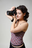 Young woman photographing Royalty Free Stock Image