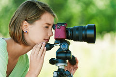 Young woman photographs Royalty Free Stock Images
