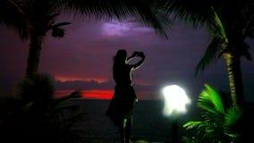 Young woman photographs beautiful sunset near. Palms, lantern on the beach. Koh Samui Thailand 1920*1080 stock footage