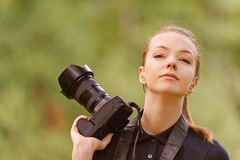 Young woman photographs on camera Stock Photography