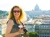 Young woman photographs the Cathedral of St. Peter, Rome Stock Images